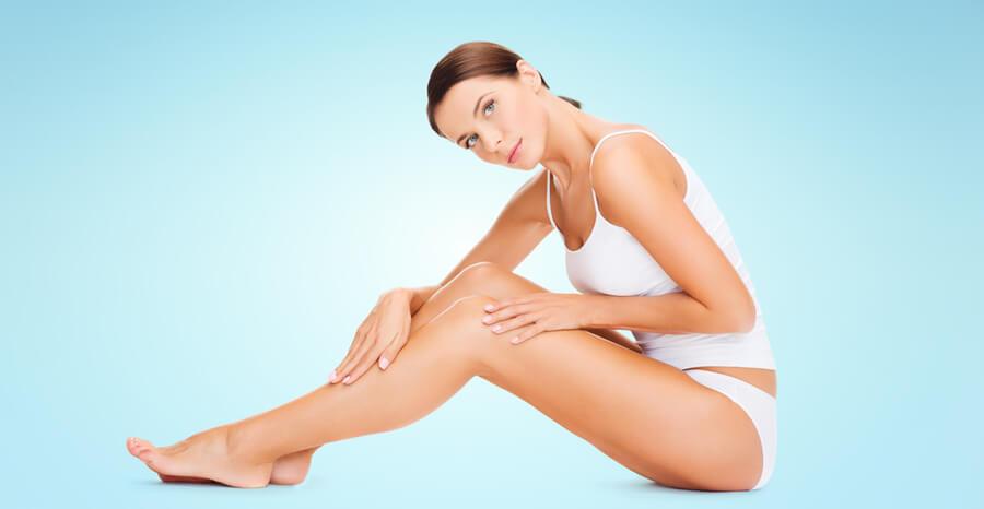 Woman touching her legs