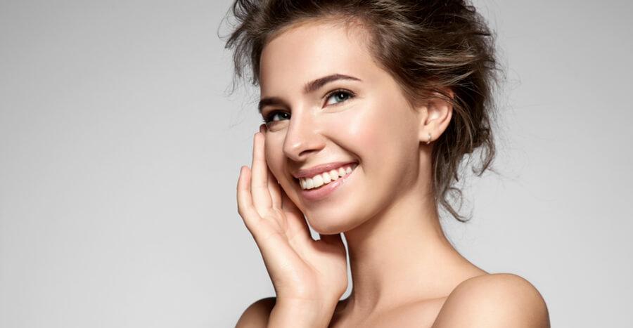 Woman touching cheek smiling
