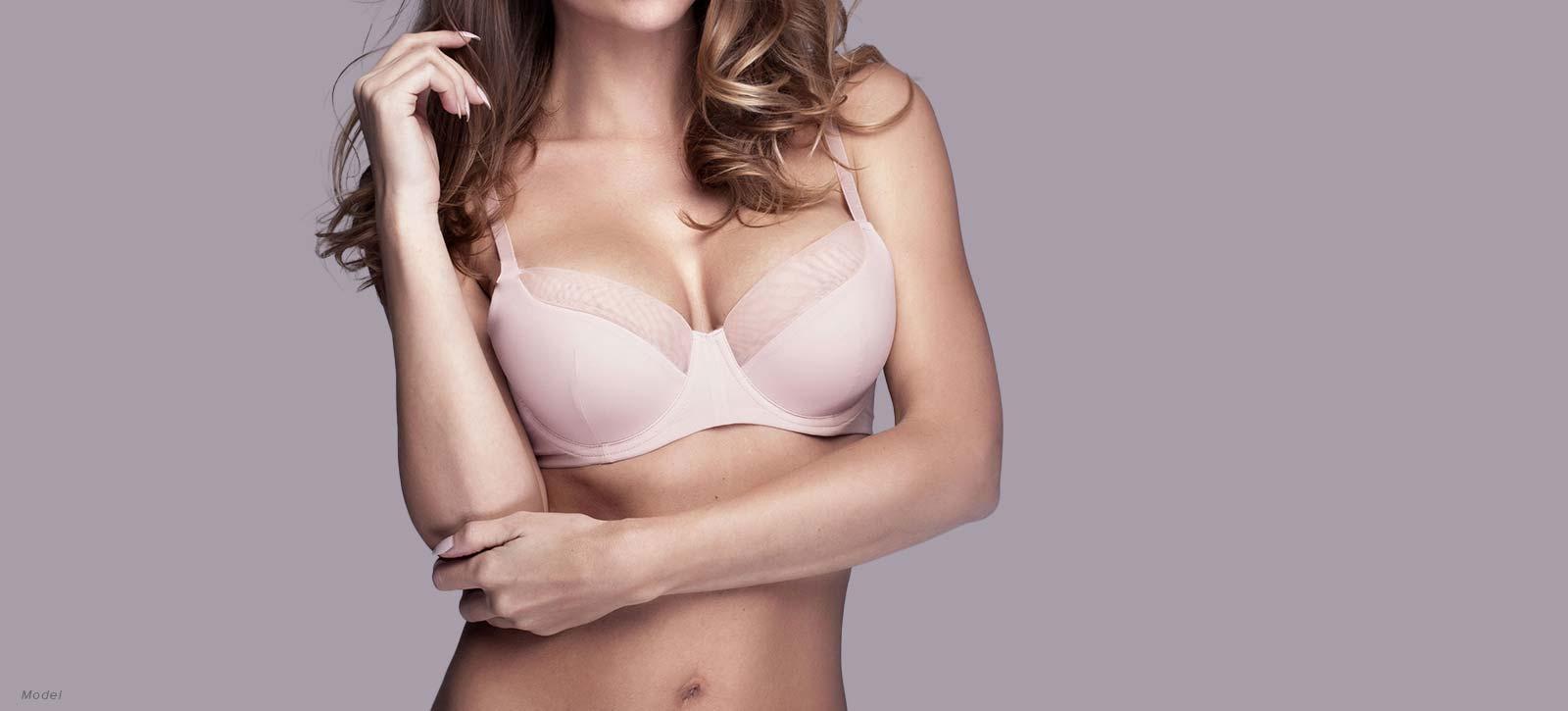 woman's body, wearing pink bra