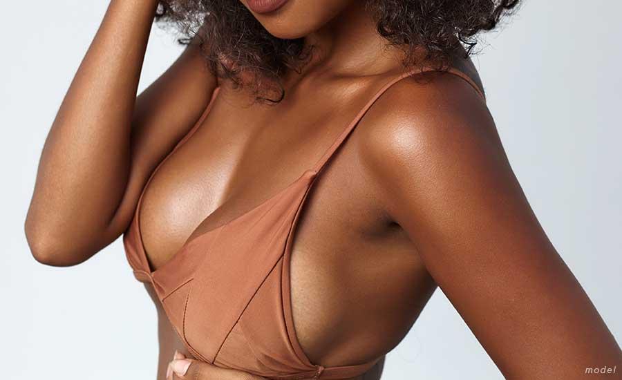 woman in brown bra