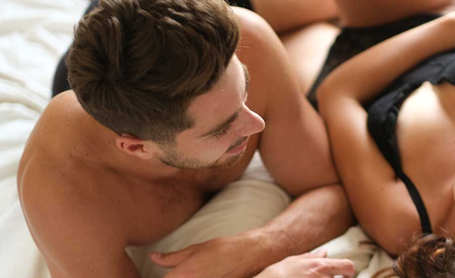 Man in bed with woman