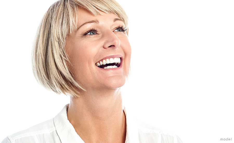 woman wearing white smiling